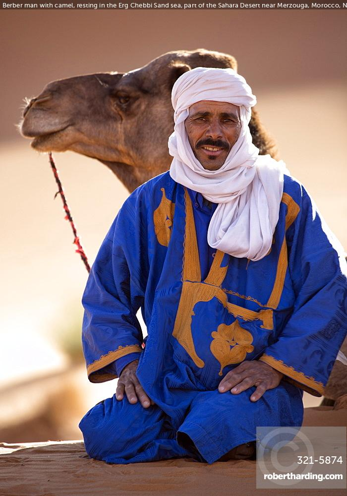 Berber man with camel, resting | Stock Photo